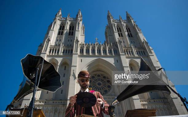 A musician attending Dardanella a Great Gatsby Lawn party plays records near the National Cathedral in Washington DC on September 23 2017...