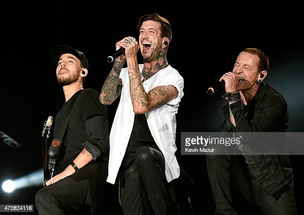 Musician Austin Carlile performs with Mike Shinoda and Chester Bennington of Linkin Park onstage during Rock In Rio USA at the MGM Resorts Festival...