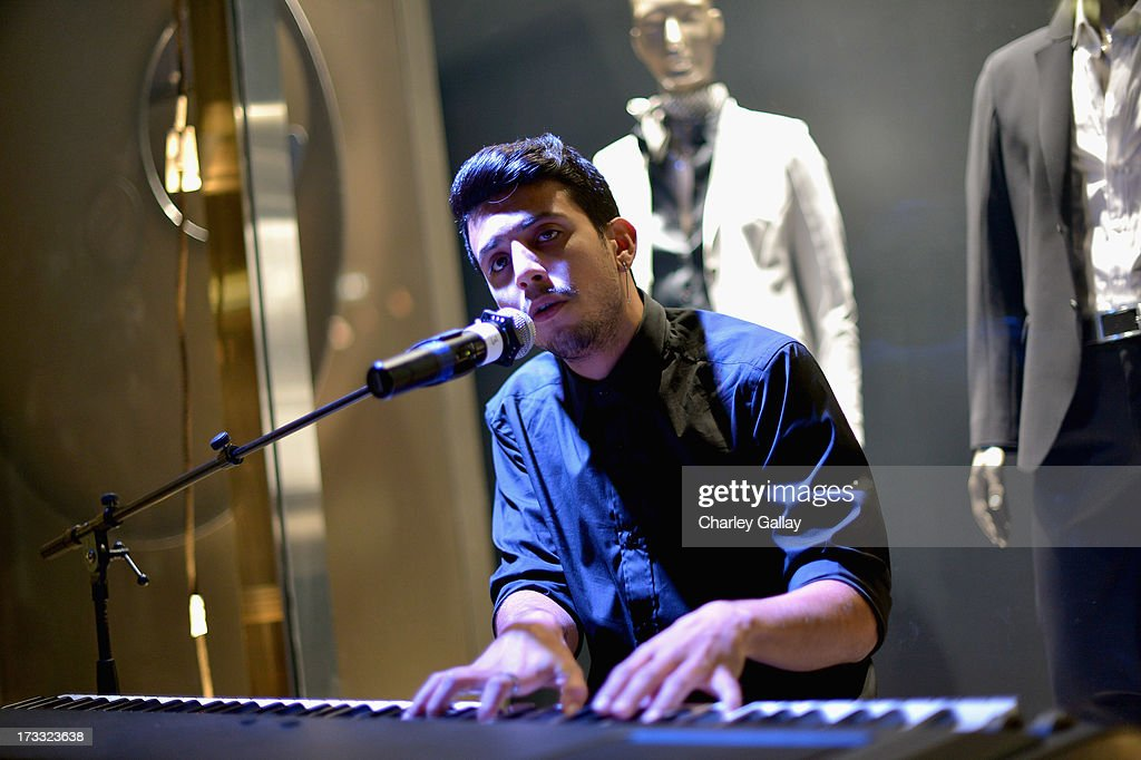 Musician Austin Paul attends the Porsche Design and Vogue re-opening event at Porsche Design Beverly Hills on July 11, 2013 in Beverly Hills, California.