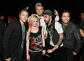 NEW YORK DECEMBER 14 EXCLUSIVE ACCESS Musician Avril Lavigne poses backstage with singers Brian Littrell Nick Carter AJ McLean and Howie Dorough of...