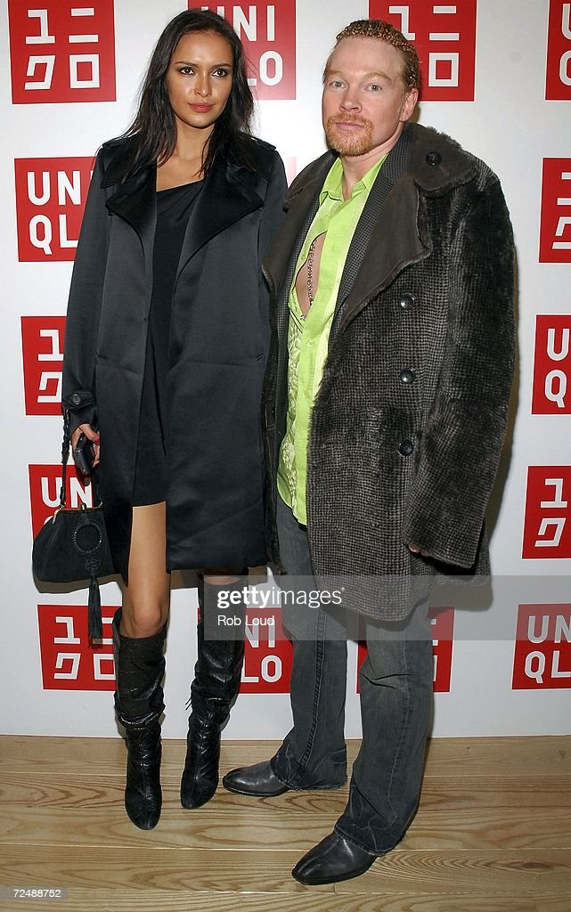 Musician Axl Rose and girlfriend Sacha arrive at the grand opening of the Uniqlo global flagship store on November 9 2006 in New York City
