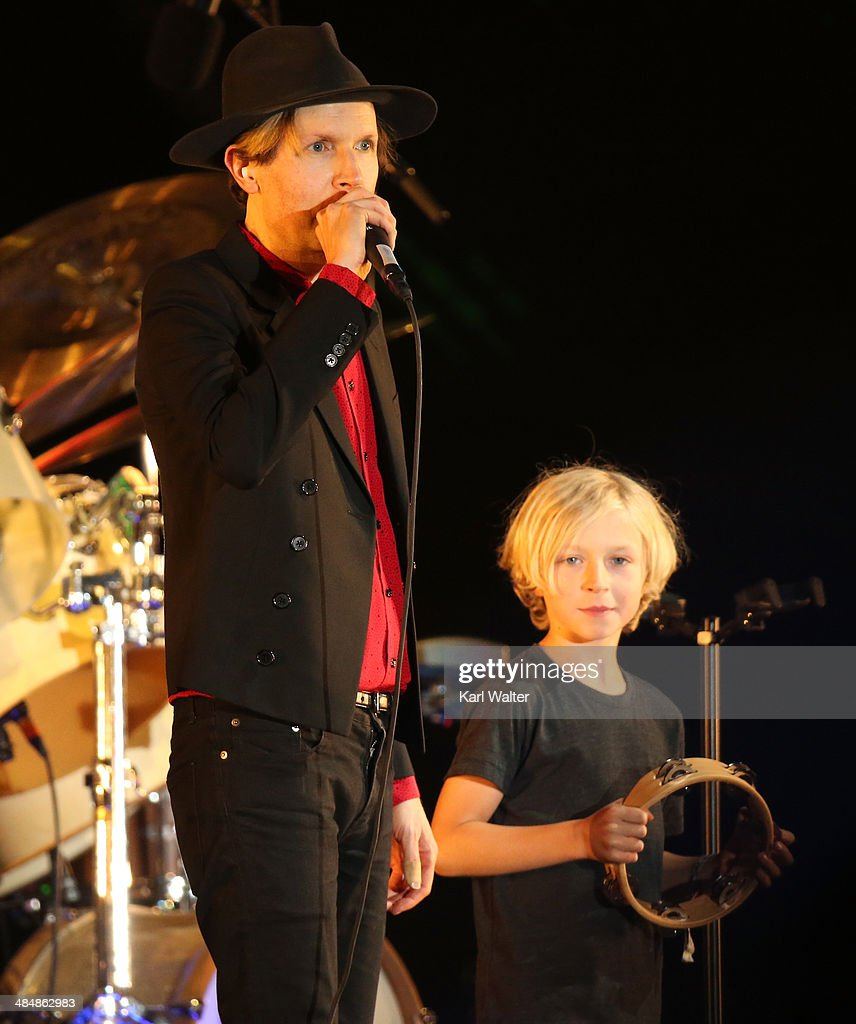 Musician Beck (L) and his son Cosimo perform onstage during day 3 of the 2014 Coachella Valley Music & Arts Festival at the Empire Polo Club on April 13, 2014 in Indio, California.