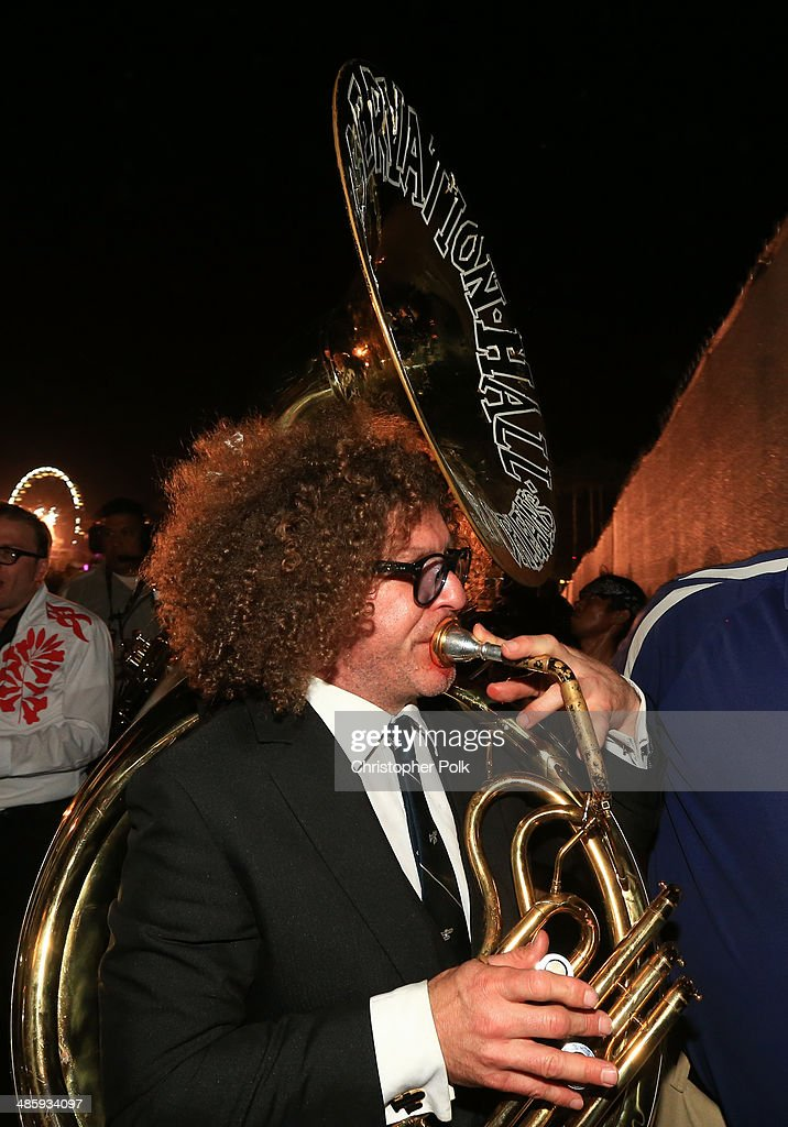 Musician Ben Jaffe of the Preservation Hall Jazz band performs with Arcade Fire in the audience during day 3 of the 2014 Coachella Valley Music & Arts Festival at the Empire Polo Club on April 20, 2014 in Indio, California.