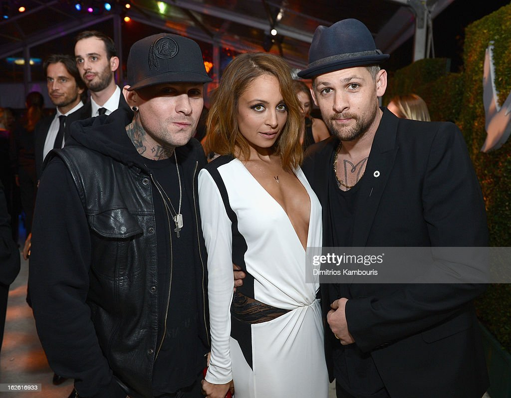 Musician <a gi-track='captionPersonalityLinkClicked' href=/galleries/search?phrase=Benji+Madden&family=editorial&specificpeople=210590 ng-click='$event.stopPropagation()'>Benji Madden</a>, <a gi-track='captionPersonalityLinkClicked' href=/galleries/search?phrase=Nicole+Richie&family=editorial&specificpeople=201646 ng-click='$event.stopPropagation()'>Nicole Richie</a> and musician <a gi-track='captionPersonalityLinkClicked' href=/galleries/search?phrase=Joel+Madden&family=editorial&specificpeople=202933 ng-click='$event.stopPropagation()'>Joel Madden</a> attend the 21st Annual Elton John AIDS Foundation Academy Awards Viewing Party at West Hollywood Park on February 24, 2013 in West Hollywood, California.