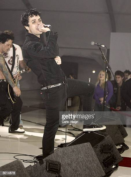 Musician Billie Joe Armstrong performs during the 3rd Annual 'ten' fashion show and charity event to celebrate awards season and car culture...