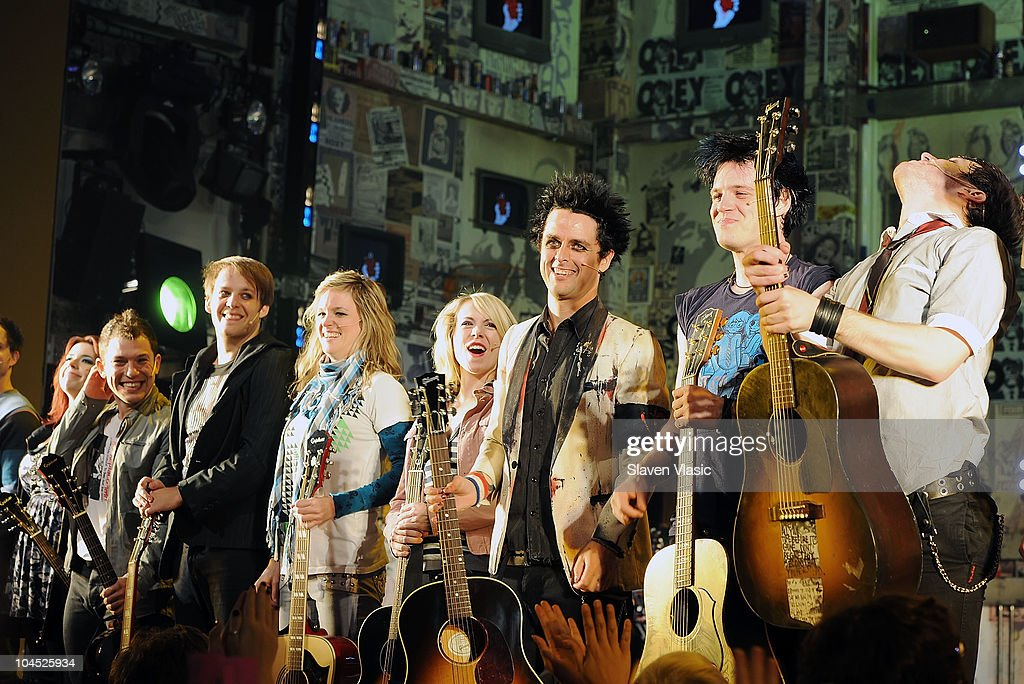 Musician <a gi-track='captionPersonalityLinkClicked' href=/galleries/search?phrase=Billie+Joe+Armstrong&family=editorial&specificpeople=201545 ng-click='$event.stopPropagation()'>Billie Joe Armstrong</a> performs with the cast of 'American Idiot' at St James Theater on September 28, 2010 in New York City.