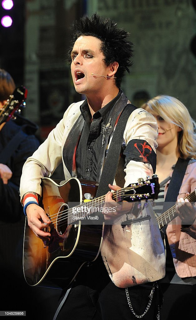 Musician Billie Joe Armstrong performs with the cast of 'American Idiot' at St James Theater on September 28, 2010 in New York City.