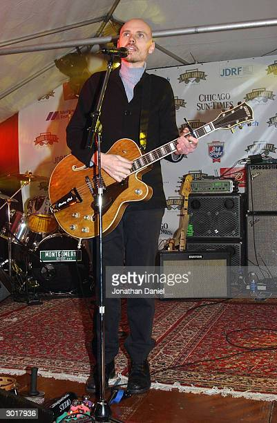 Musician Billy Corgan performs before the ceremony to destroy the cursed Chicago Cubs baseball on February 26 2004 at Harry Caray's Restaurant in...