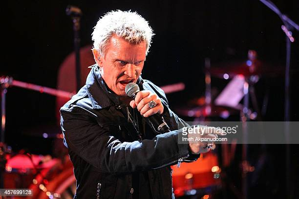 Musician Billy Idol performs onstage for SiriusXM's Artist Confidential Series at The Troubadour on October 22 2014 in Los Angeles California