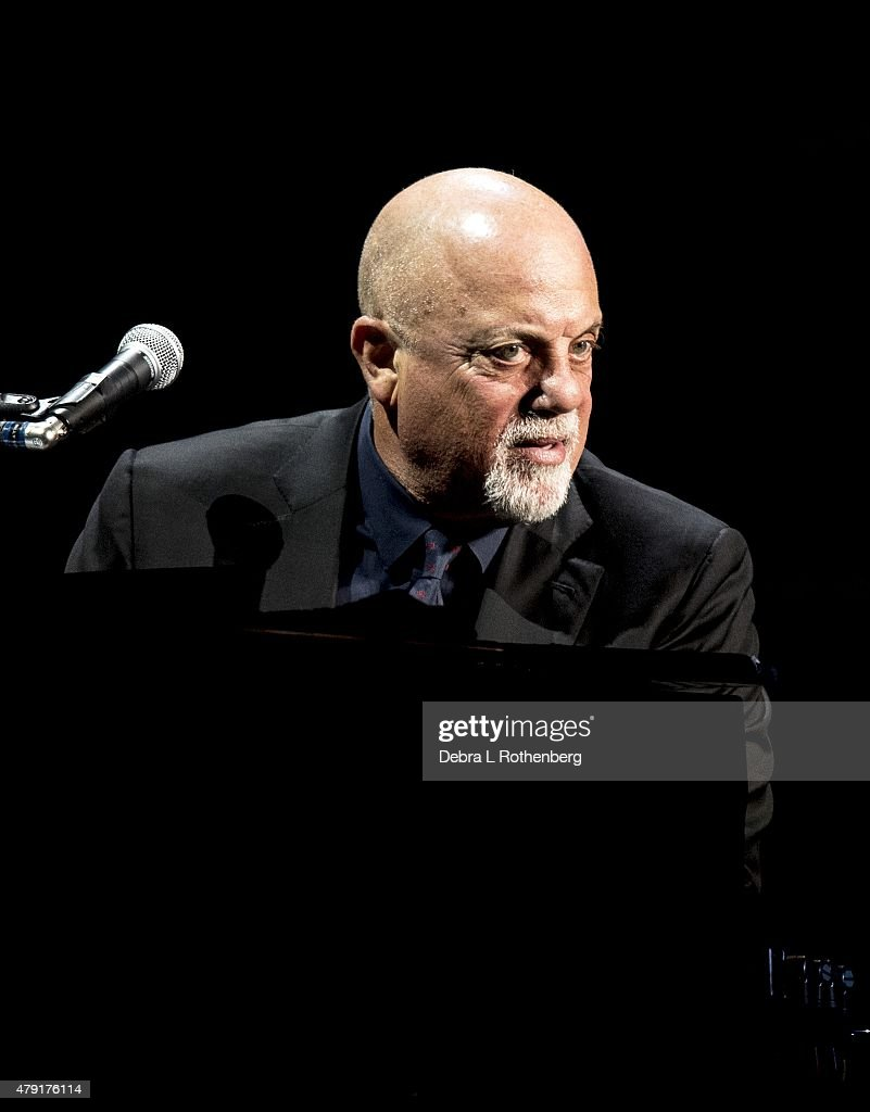 Musician <a gi-track='captionPersonalityLinkClicked' href=/galleries/search?phrase=Billy+Joel&family=editorial&specificpeople=203097 ng-click='$event.stopPropagation()'>Billy Joel</a> breaks the Madison Square Garden record by performing his 65th concert at Madison Square Garden on July 1, 2015 in New York City.