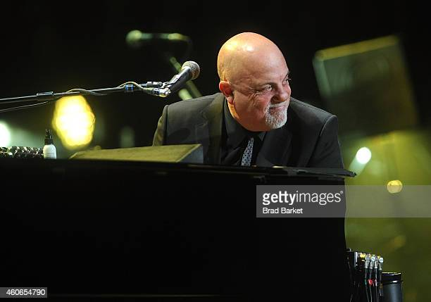 Musician Billy Joel performs at Madison Square Garden on December 18 2014 in New York City