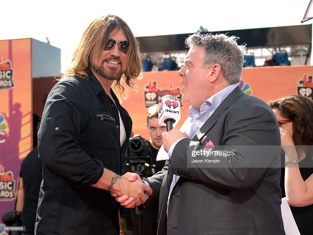 Musician Billy Ray Cyrus (L) and radio personality Elvis Duran attend the 2014 iHeartRadio Music Awards held at The Shrine Auditorium on May 1, 2014 in Los Angeles, California. iHeartRadio Music Awards are being broadcast live on NBC.