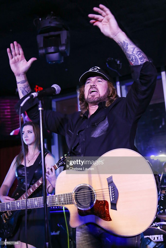 Musician <a gi-track='captionPersonalityLinkClicked' href=/galleries/search?phrase=Billy+Ray+Cyrus&family=editorial&specificpeople=213601 ng-click='$event.stopPropagation()'>Billy Ray Cyrus</a> performs at the Hellman & Waters 4th annual salute to the stars Oscar event at W Hollywood on March 2, 2014 in Hollywood, California.