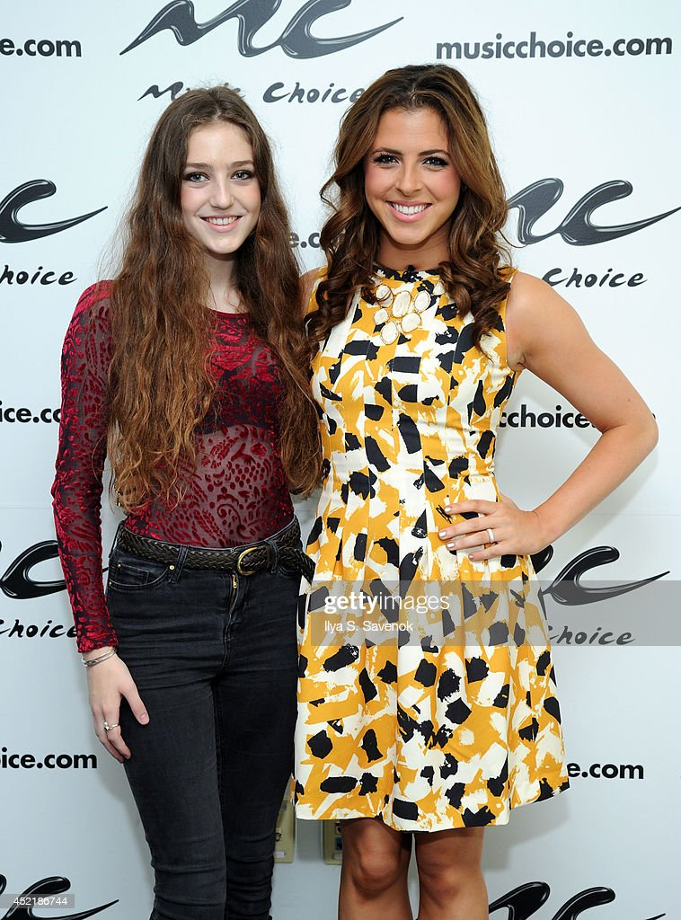 Musician 'Birdy' poses with host Clare Galterio during her visit to Music Choice's 'You & A' at Music Choice on July 15, 2014 in New York City.