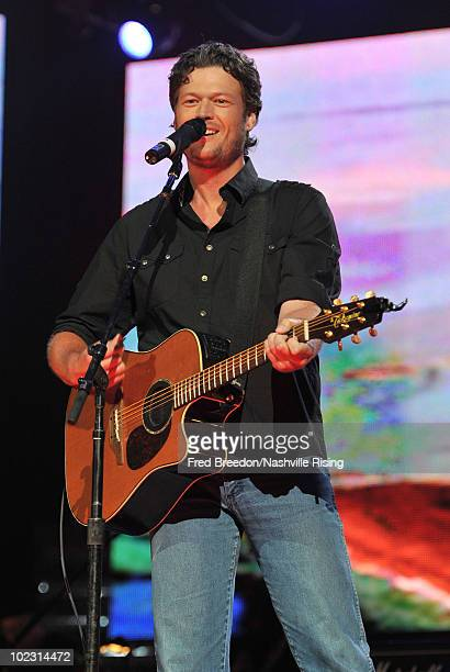 Musician Blake Shelton performs onstage at Nashville Rising a benefit concert for flood relief at Bridgestone Arena on June 22 2010 in Nashville...