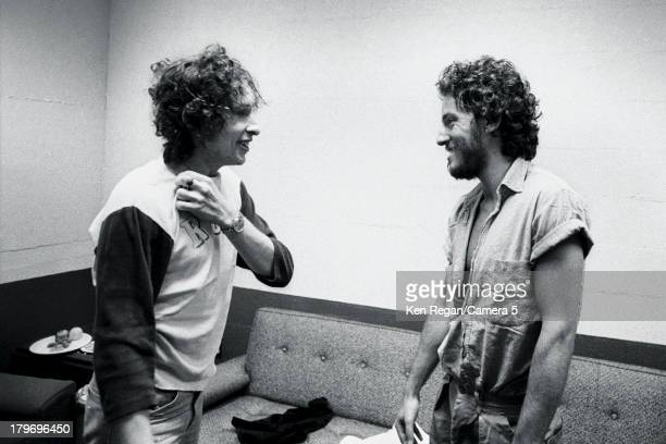 Musician Bob Dylan and Bruce Springsteen are photographed backstage during the Rolling Thunder Revue in November 1975 in New Haven Connecticut CREDIT...