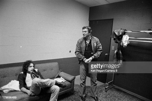 Musician Bob Dylan and concert promoter Bill Graham are photographed backstage during the Rolling Thunder Revue in November 1975 in New Haven...