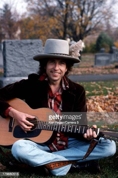 Musician Bob Dylan is photographed at Jack Keuroac's grave during the Rolling Thunder Revue in October 1975 in Lowell Massachusetts CREDIT MUST READ...