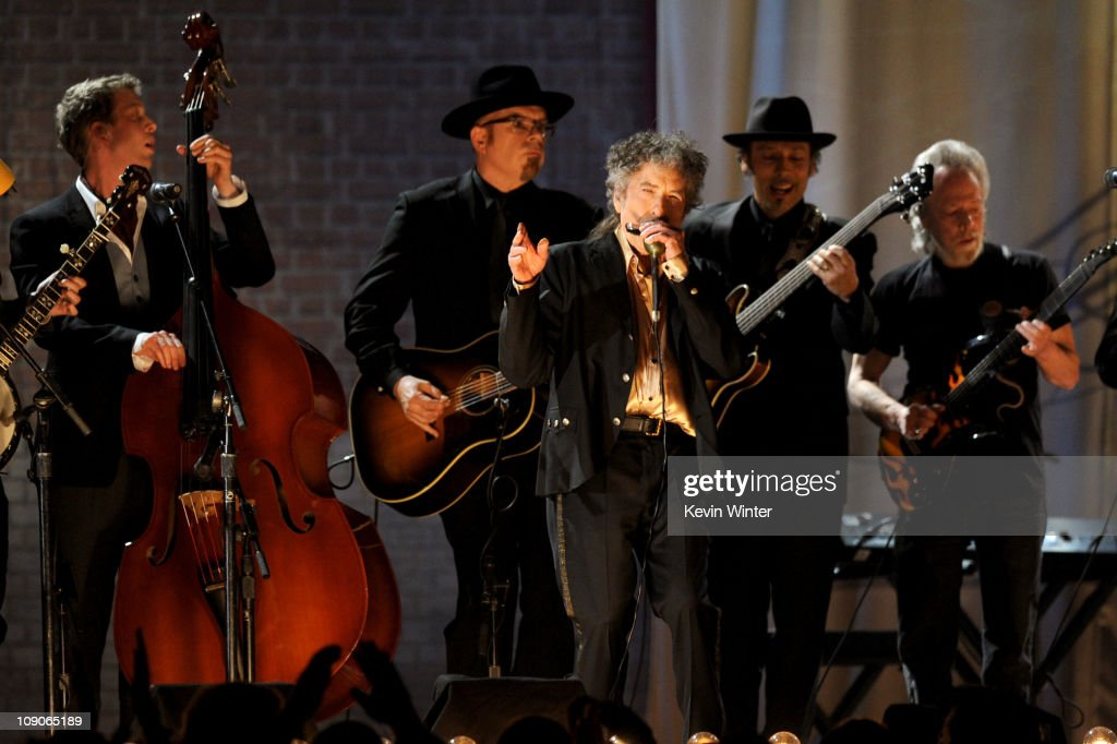 Musician <a gi-track='captionPersonalityLinkClicked' href=/galleries/search?phrase=Bob+Dylan&family=editorial&specificpeople=203289 ng-click='$event.stopPropagation()'>Bob Dylan</a> (C) performs onstage during The 53rd Annual GRAMMY Awards held at Staples Center on February 13, 2011 in Los Angeles, California.