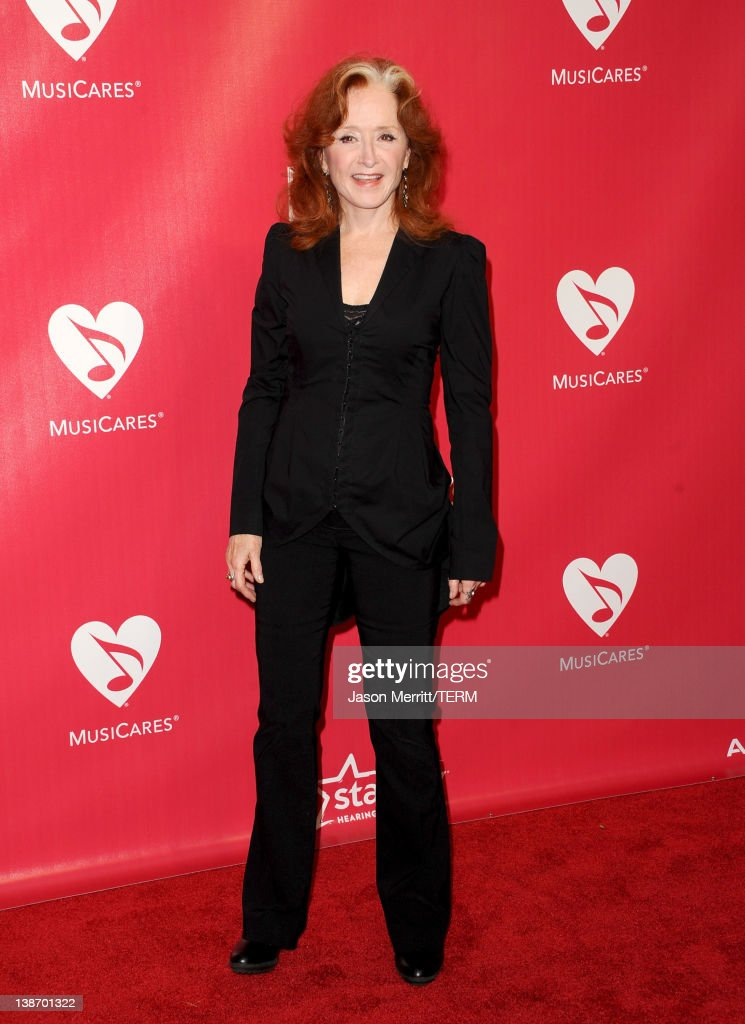 Musician Bonnie Raitt arrives at the 2012 MusiCares Person of the Year Tribute To Paul McCartney held at the Los Angeles Convention Center on February 10, 2012 in Los Angeles, California.