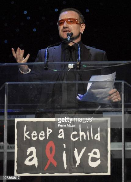 Musician Bono accepts award at Conde Nast Media Group's 4th Annual 'Black Ball' Concert for 'Keep A Child Alive' at Hammerstein Ballroom on October...