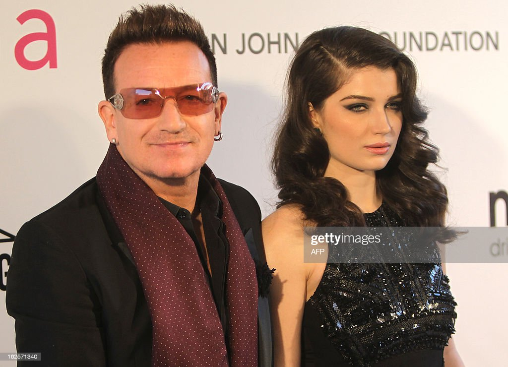 Musician Bono (L) and actress Eve Hewson arrive for the 21st Annual Elton John AIDS Foundation's Oscar Viewing Party February 24, 2013 in Hollywood, California. AFP PHOTO/Mehdi TAAMALLAH