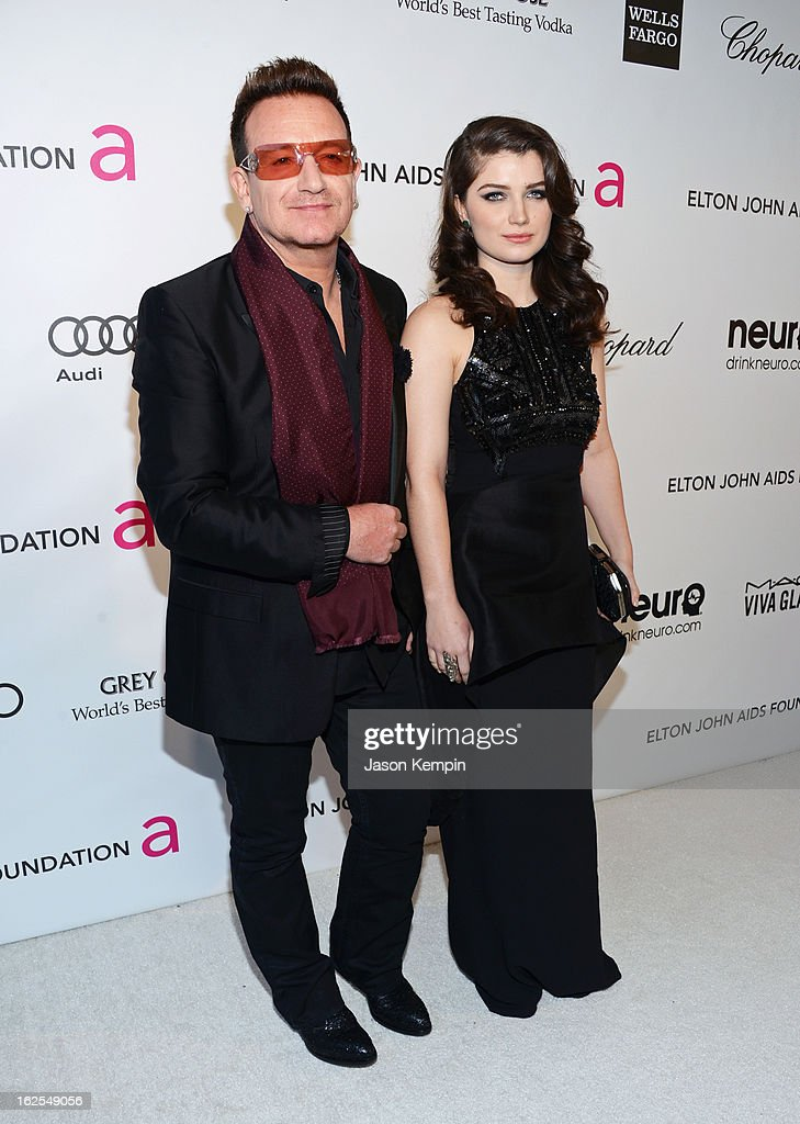 Musician Bono (L) and actress Eve Hewson attend the 21st Annual Elton John AIDS Foundation Academy Awards Viewing Party at West Hollywood Park on February 24, 2013 in West Hollywood, California.