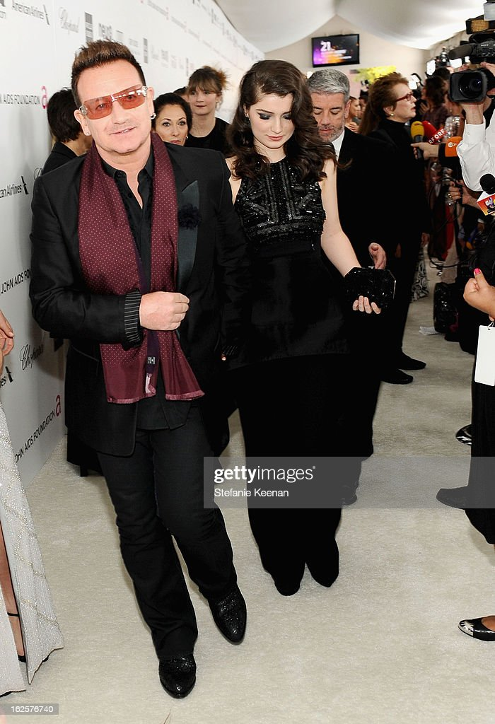 Musician Bono and daughter Eve Hewson attend Chopard at 21st Annual Elton John AIDS Foundation Academy Awards Viewing Party at West Hollywood Park on February 24, 2013 in West Hollywood, California.