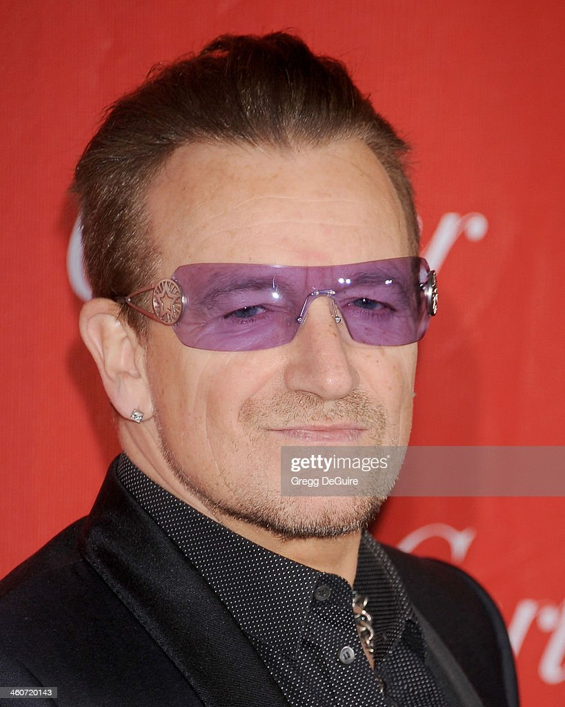 Musician <a gi-track='captionPersonalityLinkClicked' href=/galleries/search?phrase=Bono&family=editorial&specificpeople=167279 ng-click='$event.stopPropagation()'>Bono</a> arrives at the 25th Annual Palm Springs International Film Festival Awards Gala at Palm Springs Convention Center on January 4, 2014 in Palm Springs, California.