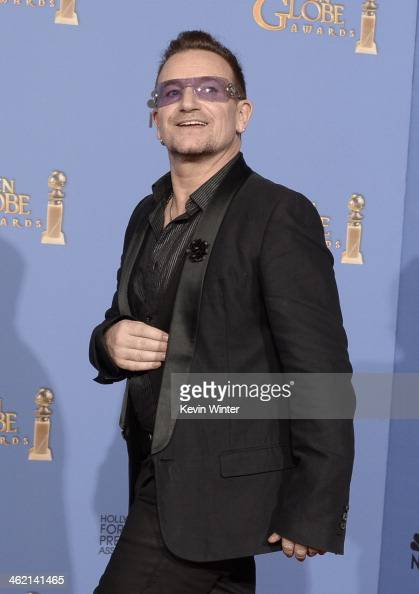 Musician Bono of U2 winner of Best Original Song for 'Ordinary Love' from 'Mandela Long Walk to Freedom' poses in the press room during the 71st...