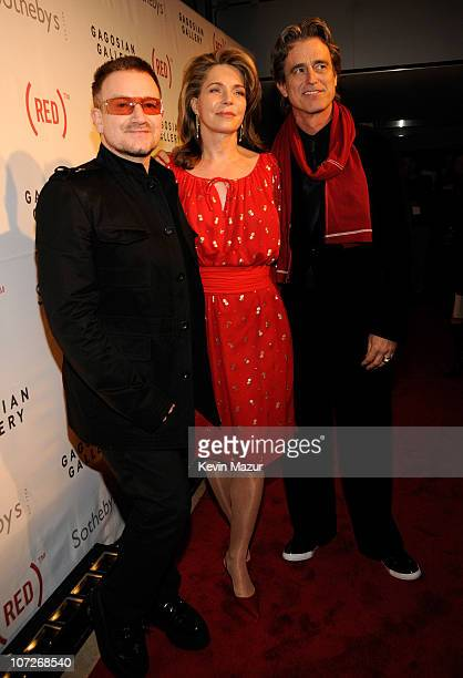 Musician Bono Queen Noor and Bobby Shriver arrive at Sotheby's Bono and Damien Hirst Host The Auction to Benefit AIDS in Africa on February 14 2008...