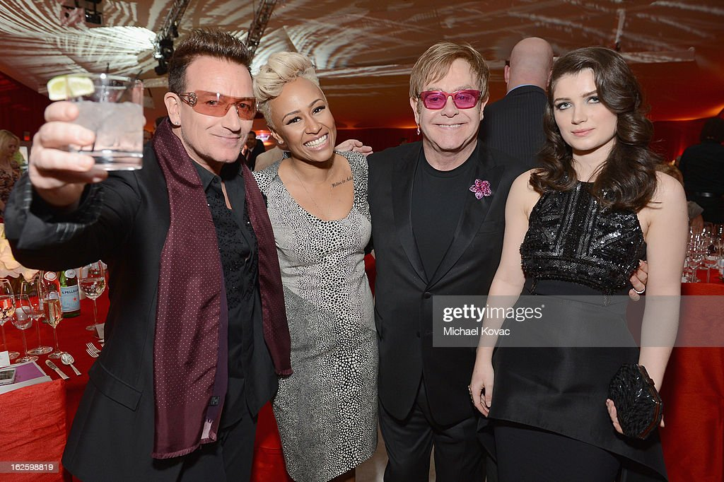 Musician Bono; Singer Emeli Sande, Sir Elton John, and actress Eve Hewson attends the 21st Annual Elton John AIDS Foundation Academy Awards Viewing Party at West Hollywood Park on February 24, 2013 in West Hollywood, California.
