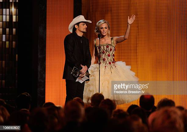 Musician Brad Paisley accepts an award onstage alongside host Carrie Underwood at the 44th Annual CMA Awards at the Bridgestone Arena on November 10...