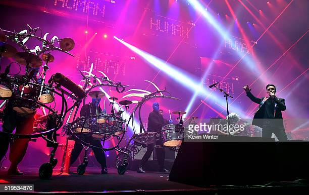 Musician Brandon Flowers of The Killers performs with Blue Man Group onstage during the grand opening of TMobile Arena on April 6 2016 in Las Vegas...