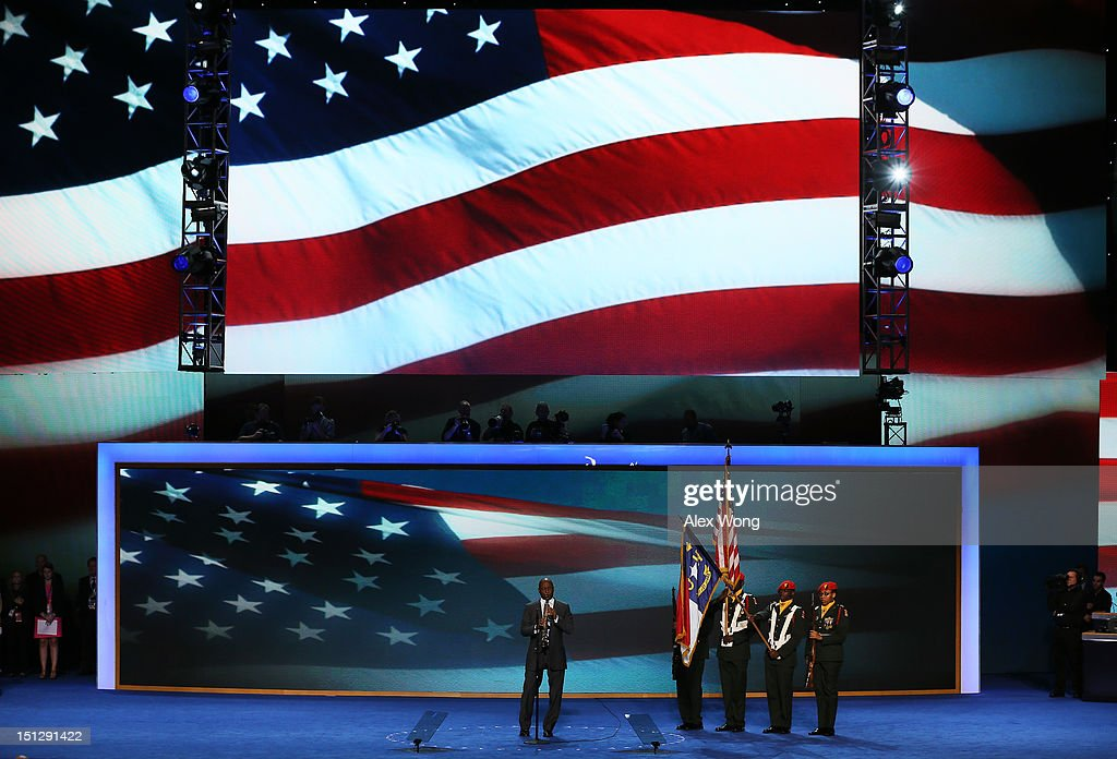 Musician Branford Marsalis performs the national anthem as the West Charlotte High School ROTC present the colors during day two of the Democratic National Convention at Time Warner Cable Arena on September 5, 2012 in Charlotte, North Carolina. The DNC that will run through September 7, will nominate U.S. President Barack Obama as the Democratic presidential candidate.