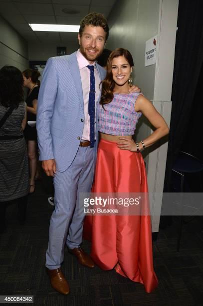 Musician Brett Eldredge and Cassadee Pope attend the 2014 CMT Music awards at the Bridgestone Arena on June 4 2014 in Nashville Tennessee