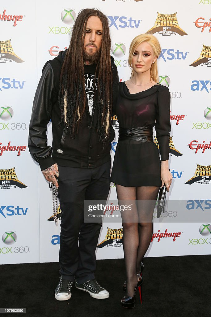Musician Brian 'Head' Welch of Korn (L) and actress Xhoana Xheneti arrive at the 5th Annual Revolver Golden Gods awards show at Club Nokia on May 2, 2013 in Los Angeles, California.