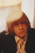 Musician Brian Jones from The Rolling Stones wearing a white silk shirt in May 1968