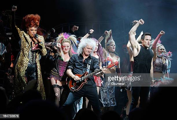 Musician Brian May performs onstage with the cast of 'We Will Rock You' during the 'We Will Rock You' National Tour opening night at the Hippodrome...
