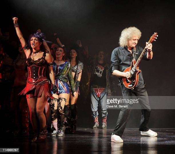 Musician Brian May performs with cast members during the 9th anniversary performance of 'We Will Rock You' at the Dominion Theatre on May 31 2011 in...