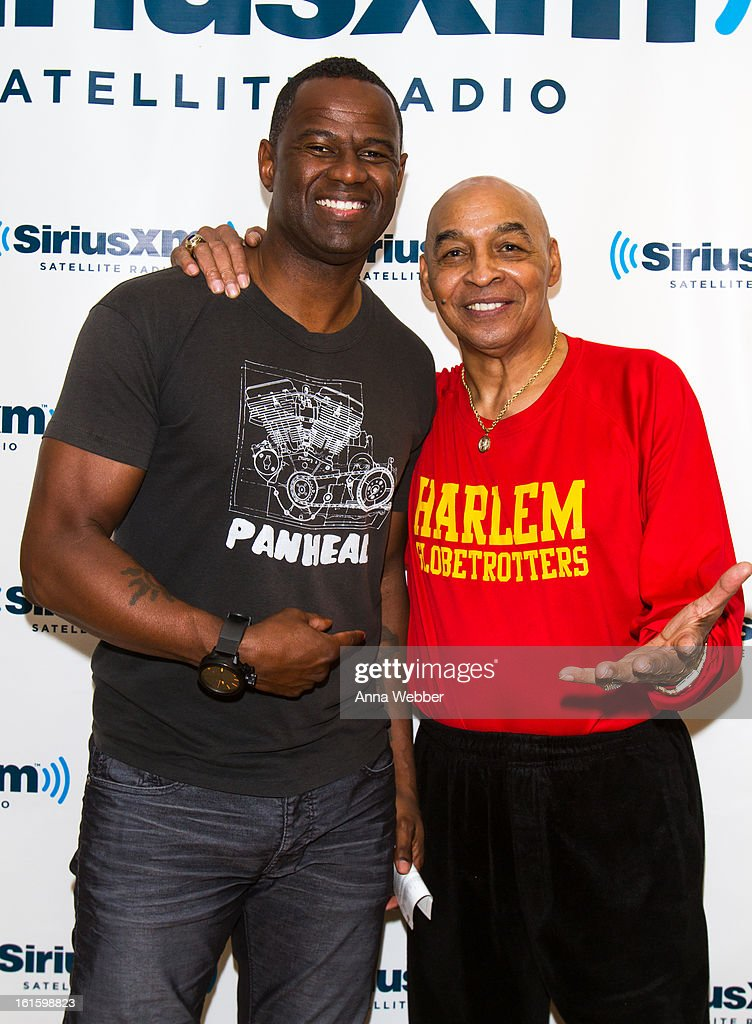 Musician Brian McKnight and Harlem Globe Trotter Curly Neal visit SiriusXM Studios on February 12, 2013 in New York City.