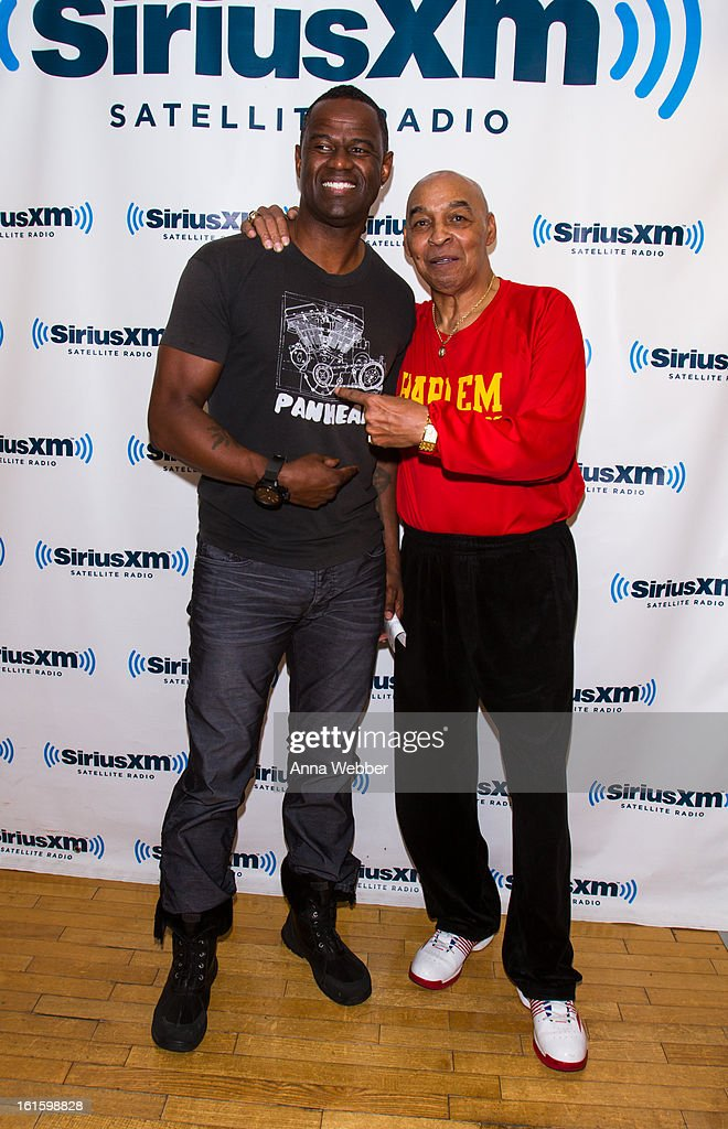Musician <a gi-track='captionPersonalityLinkClicked' href=/galleries/search?phrase=Brian+McKnight&family=editorial&specificpeople=206619 ng-click='$event.stopPropagation()'>Brian McKnight</a> and Harlem Globe Trotter Curly Neal visit SiriusXM Studios on February 12, 2013 in New York City.