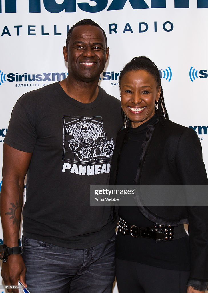 Musician Brian McKnight and SiriusXM radio host B. Smith visit SiriusXM Studios on February 12, 2013 in New York City.