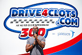 Musician Brian McKnight performs the National Anthem before the NASCAR XFINITY Series Drive4Clotscom 300 at Auto Club Speedway on March 21 2015 in...