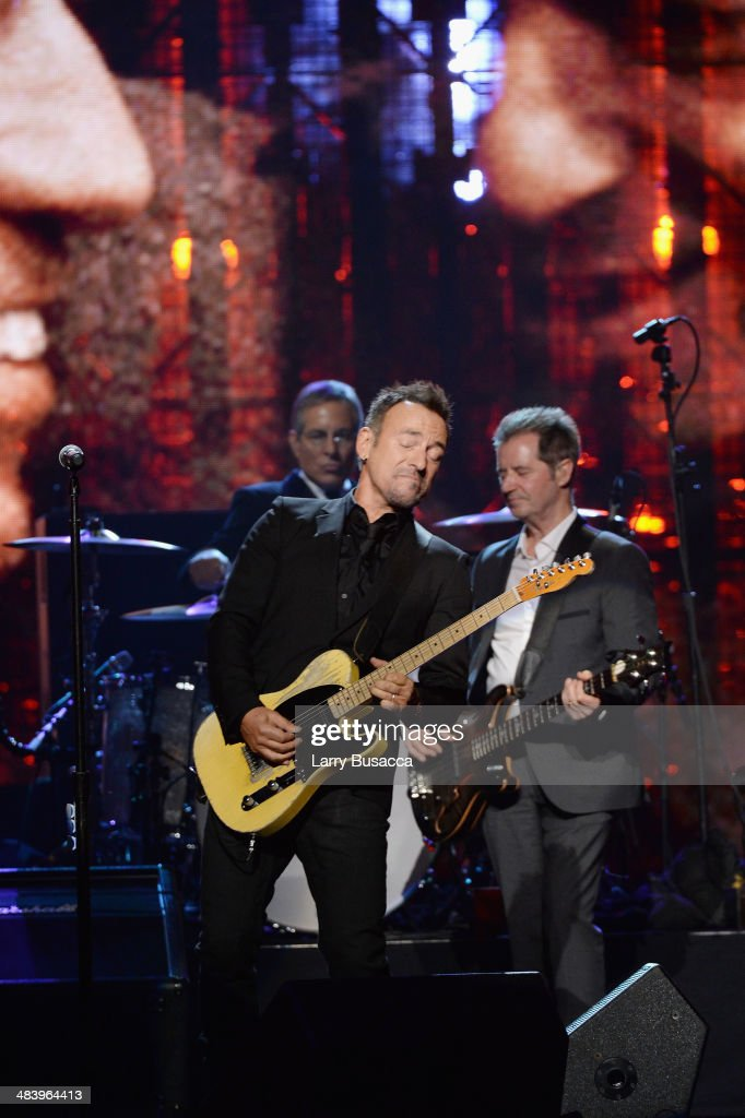 Musician <a gi-track='captionPersonalityLinkClicked' href=/galleries/search?phrase=Bruce+Springsteen&family=editorial&specificpeople=123832 ng-click='$event.stopPropagation()'>Bruce Springsteen</a> and Inductee <a gi-track='captionPersonalityLinkClicked' href=/galleries/search?phrase=Garry+Tallent&family=editorial&specificpeople=3621696 ng-click='$event.stopPropagation()'>Garry Tallent</a> of the E Street Band perform onstage at the 29th Annual Rock And Roll Hall Of Fame Induction Ceremony at Barclays Center of Brooklyn on April 10, 2014 in New York City.