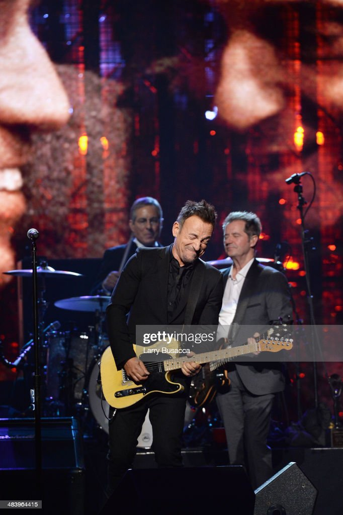 Musician Bruce Springsteen and Inductee Garry Tallent of the E Street Band perform onstage at the 29th Annual Rock And Roll Hall Of Fame Induction Ceremony at Barclays Center of Brooklyn on April 10, 2014 in New York City.