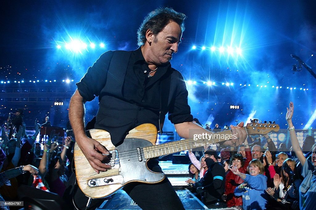 Musician <a gi-track='captionPersonalityLinkClicked' href=/galleries/search?phrase=Bruce+Springsteen&family=editorial&specificpeople=123832 ng-click='$event.stopPropagation()'>Bruce Springsteen</a> and the E Street Band perform at the Bridgestone halftime show during Super Bowl XLIII between the Arizona Cardinals and the Pittsburgh Steelers on February 1, 2009 at Raymond James Stadium in Tampa, Florida.