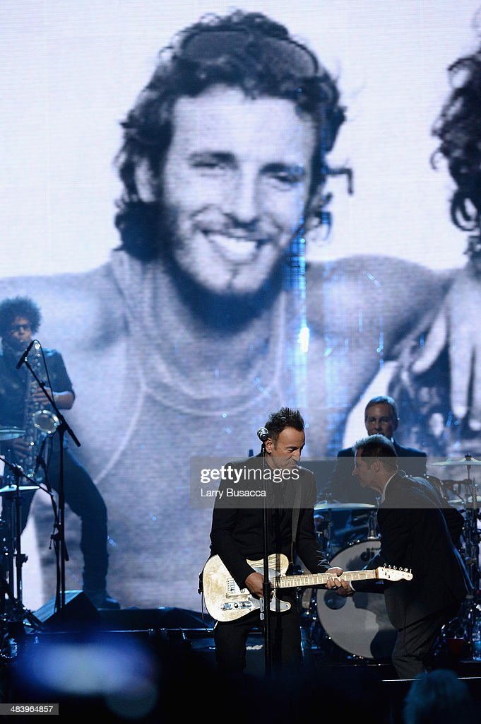 Musician <a gi-track='captionPersonalityLinkClicked' href=/galleries/search?phrase=Bruce+Springsteen&family=editorial&specificpeople=123832 ng-click='$event.stopPropagation()'>Bruce Springsteen</a>performs onstage with <a gi-track='captionPersonalityLinkClicked' href=/galleries/search?phrase=Garry+Tallent&family=editorial&specificpeople=3621696 ng-click='$event.stopPropagation()'>Garry Tallent</a> and <a gi-track='captionPersonalityLinkClicked' href=/galleries/search?phrase=Max+Weinberg&family=editorial&specificpeople=1059983 ng-click='$event.stopPropagation()'>Max Weinberg</a> of the E Street Band at the 29th Annual Rock And Roll Hall Of Fame Induction Ceremony at Barclays Center of Brooklyn on April 10, 2014 in New York City.