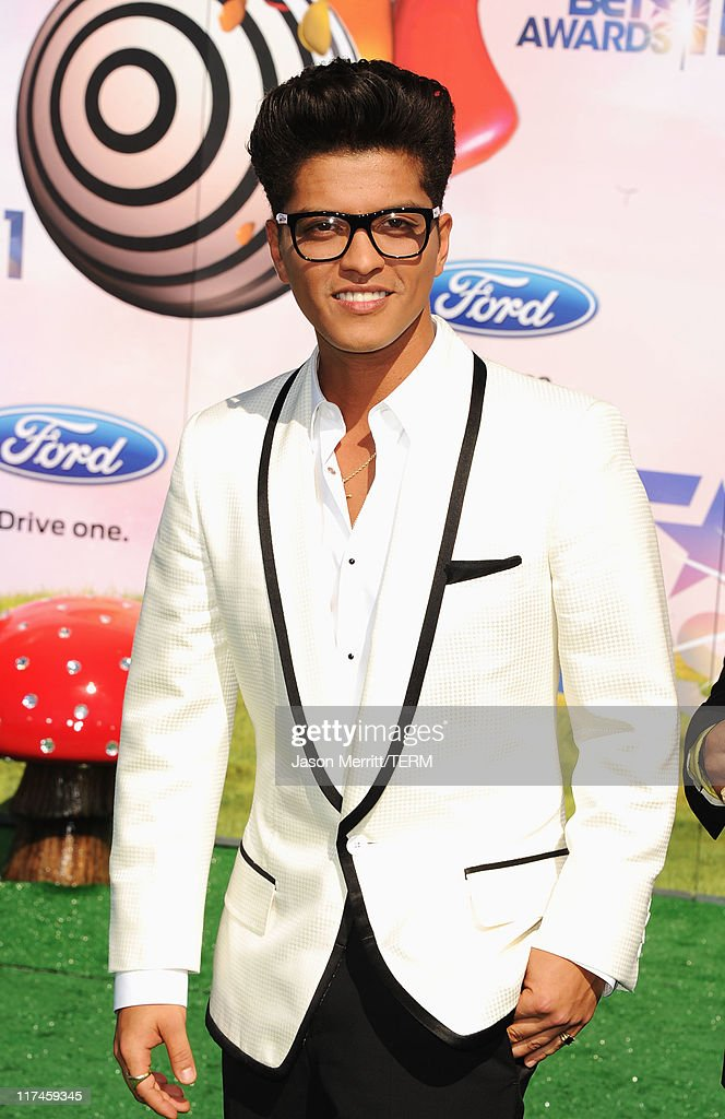 Musician <a gi-track='captionPersonalityLinkClicked' href=/galleries/search?phrase=Bruno+Mars&family=editorial&specificpeople=6779692 ng-click='$event.stopPropagation()'>Bruno Mars</a> arrives at the BET Awards '11 held at the Shrine Auditorium on June 26, 2011 in Los Angeles, California.