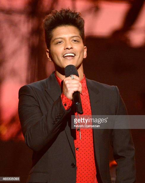 Musician Bruno Mars speaks onstage during the 56th GRAMMY Awards at Staples Center on January 26 2014 in Los Angeles California